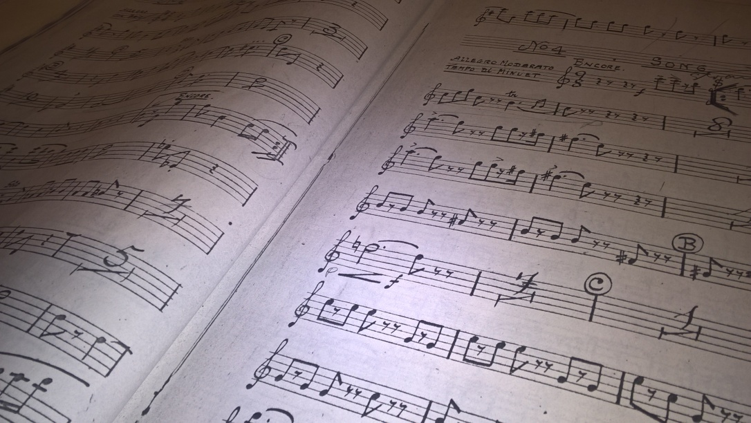 A close-up photo of a double-page spread of the sheet music for the oboe part of 'The Mikado'